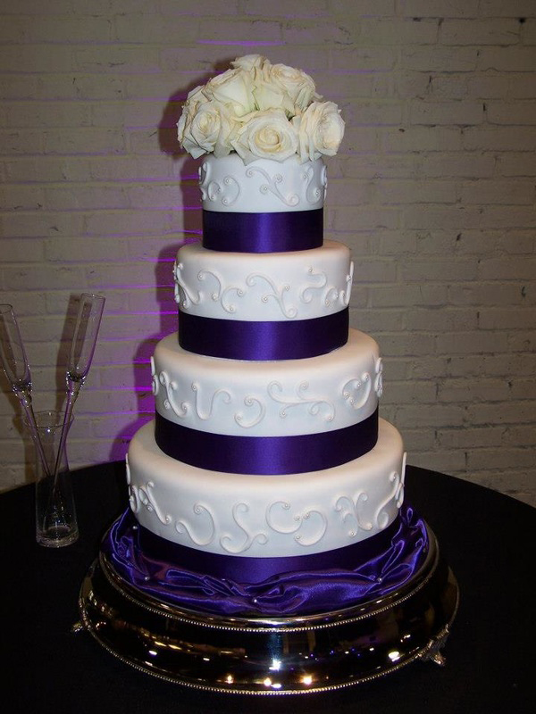 Baltimore, MD 4 tiered purple white wedding cake phillips fairy tale weddings
